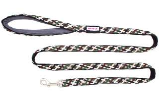 Top view of brown, green, and black dog leash