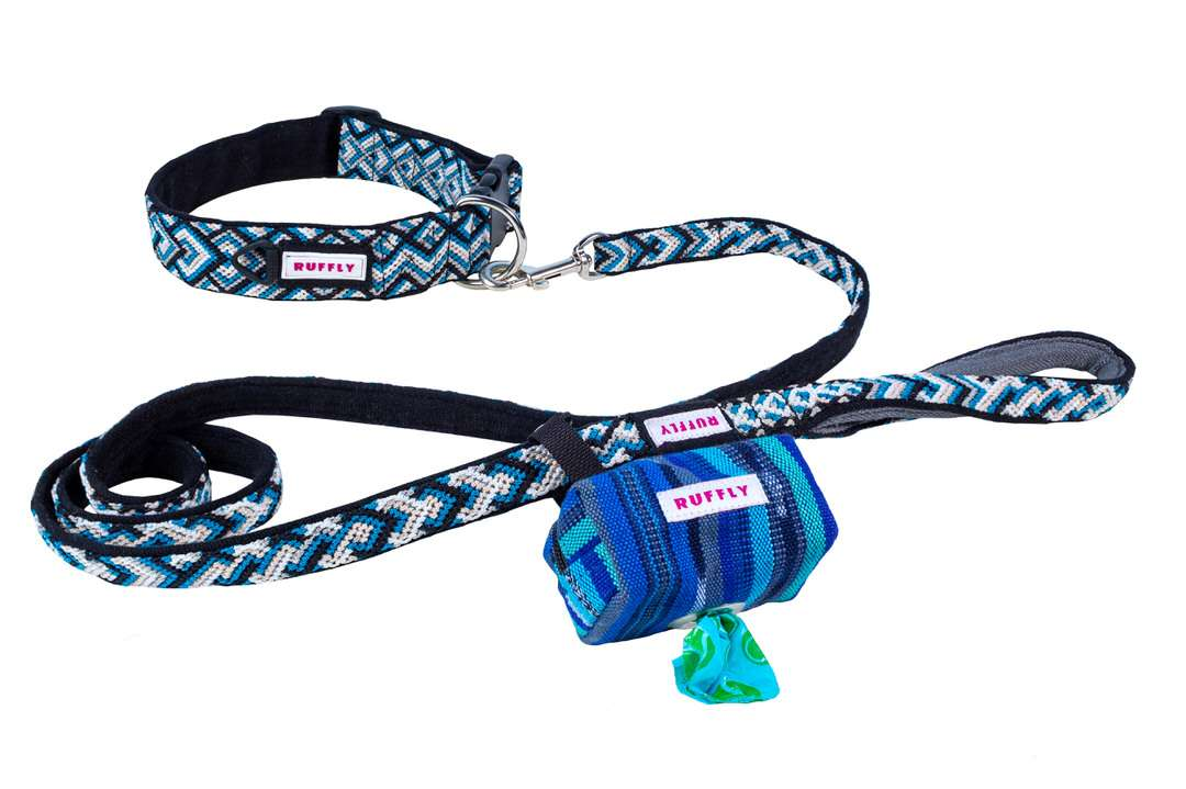 Blue and black outdoor collar connected to leash with a matching poop bag holder