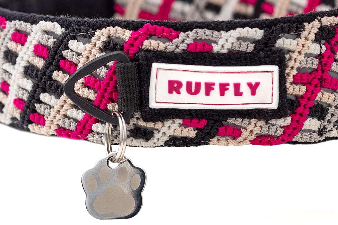 Closeup of No Jingle ID Tag Ring on a pink and black handmade dog collar