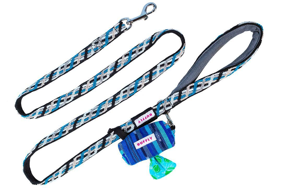 Blue and black dog leash in zigzag pattern with teardrop handle and matching poop bag holder