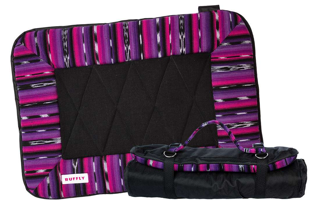 Pink, purple, and black dog travel bed open and rolled up with carrying strap