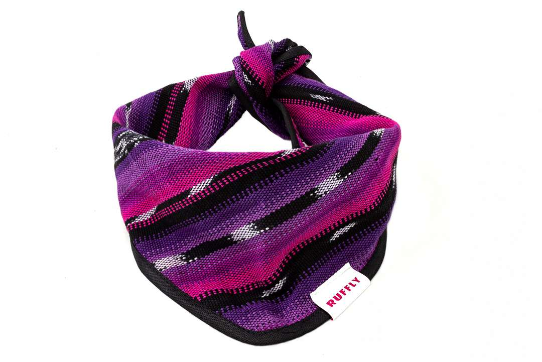 Top view of pink and purple dog bandana with classic knot tie design