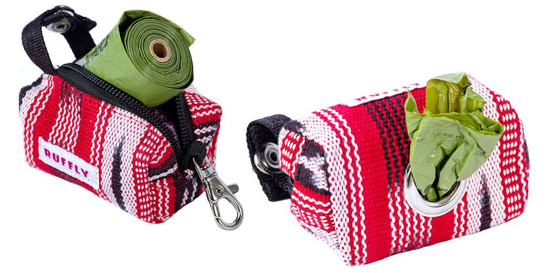 Green bag roll in red poop bag holder and dispensing from stainless eyelet