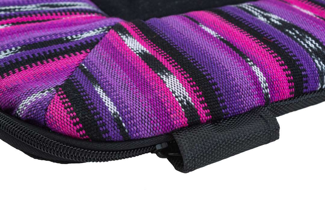 Rugged zipper protector on pink, purple, and black dog bed