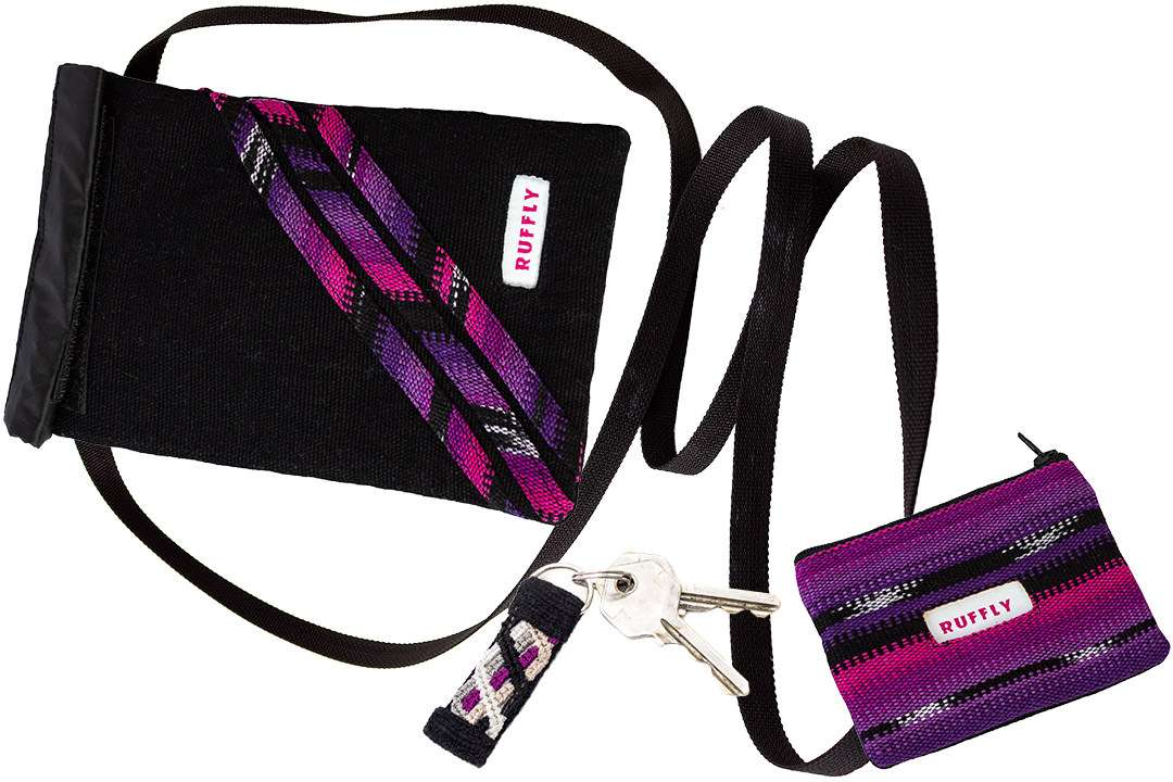Matching pink, purple, and black travel and everyday accessories including keychain, wallet, and crossbody bag