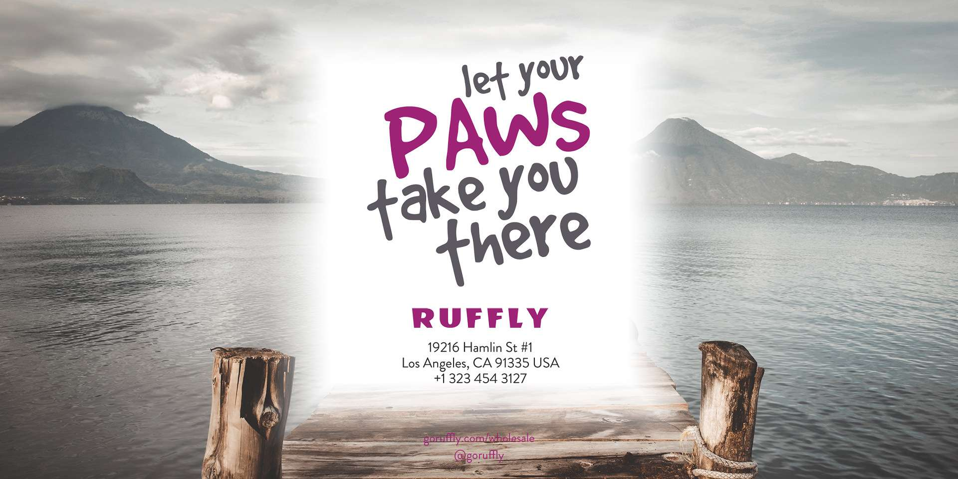 The back cover of RUFFLY's lookbook catalogue of dog gear features the contact information and Let Your Paws Take You There motto
