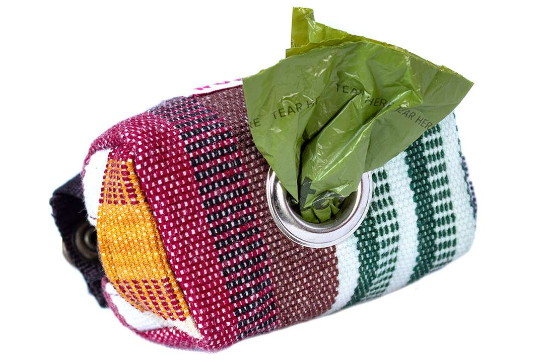 Side view of leather-free dog poop bag holder in blue colorfast handwoven cotton fabric