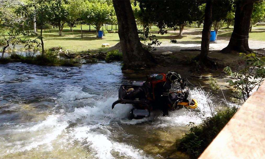 Man crashes motorcycle during river crossing with German Shepherd riding in motorcycle dog carrier