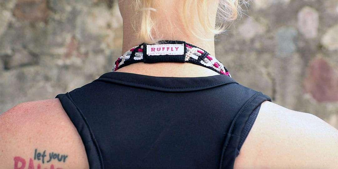Minimalist camera strap around the back of blonde woman's neck
