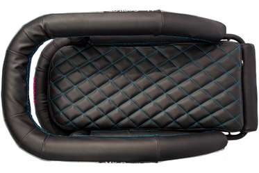 Motorcycle dog carrier with black vinyl and blue stitching seen from top angle
