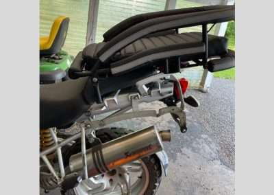 Large motorcycle dog carrier mounted to the luggage rack of a BMW adventure motorcycle