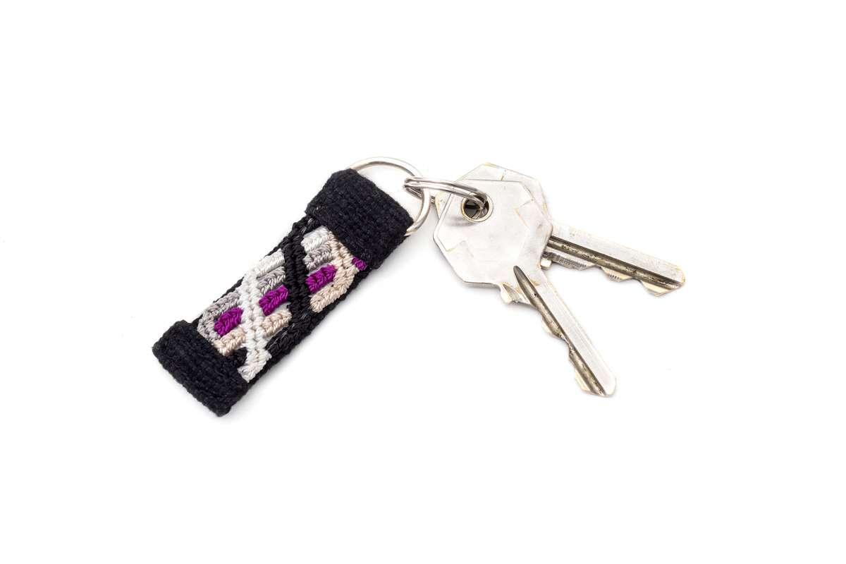 Purple handmade reflective knotted keychain with keys