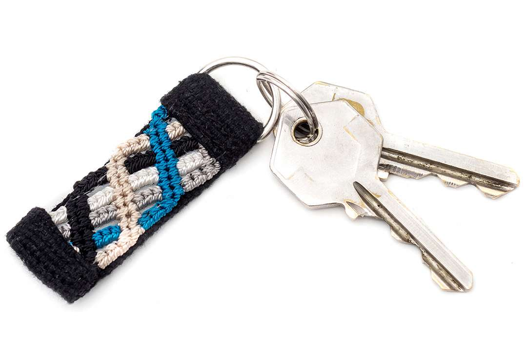 Blue artisan-made keychain with stainless D-ring and reflective ribbon