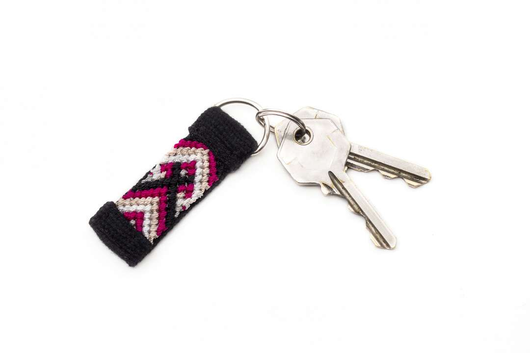 Pink handmade keychain with reflective ribbon and handwoven cotton fabric