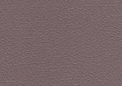Square swatch of vinyl upholstery in mauve fake rawhide leather