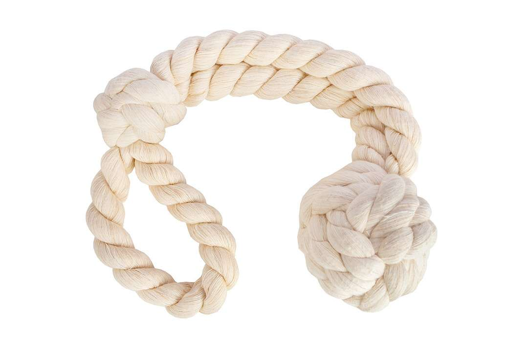 Natural cotton dye-free monkey fist knot dog toy in a horseshoe layout