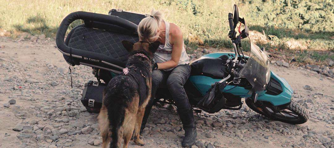 German shepherd shows affection to young woman after off-road motorcycle crash