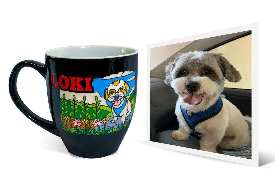 "Gorgeous photo of white and beige dog in car seat next to personalized black cup that says ""Loki"""