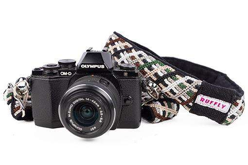 Outdoor reflect camera strap in brown and green with Olympus camera