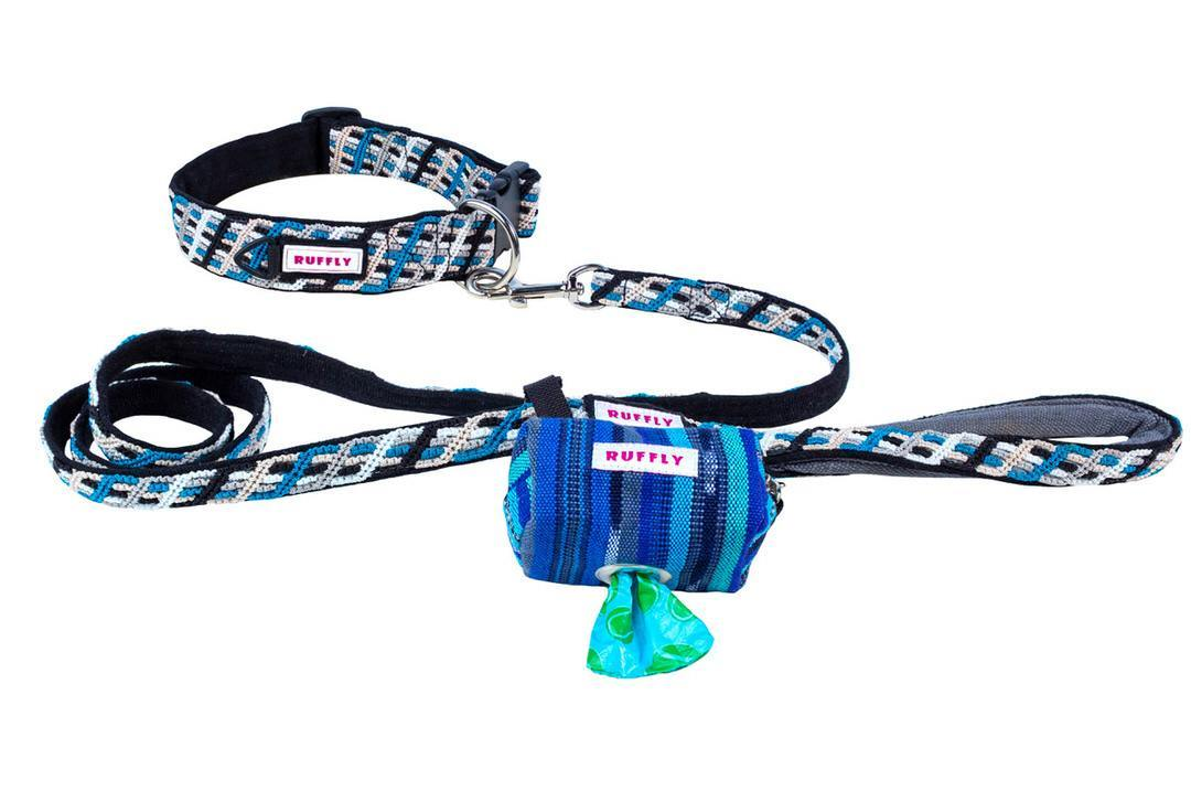 Handwoven dog poop bag holder attached to matching blue reflective leash that is connected to matching leather-free collar