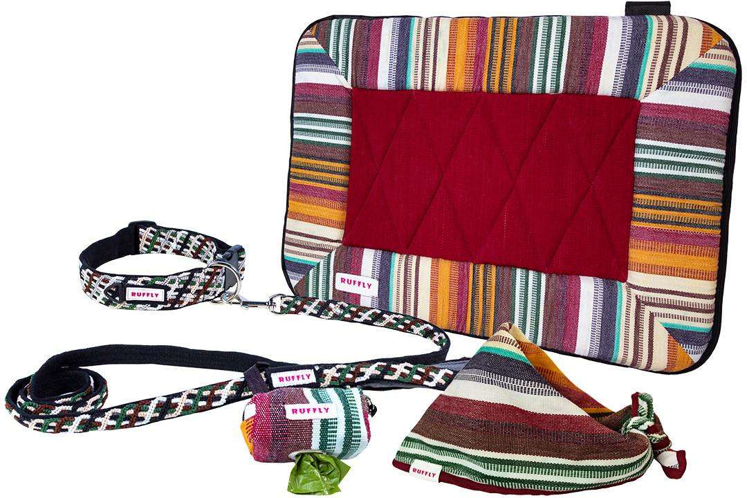 Handmade outdoor dog gear kit includes matching collar, leash, poop bag holder, bed, and bandana