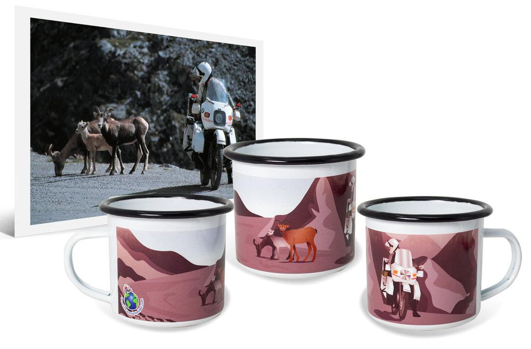 Photo of man on motorcycle beside deer next to custom camping coffee mug with cartoon artwork