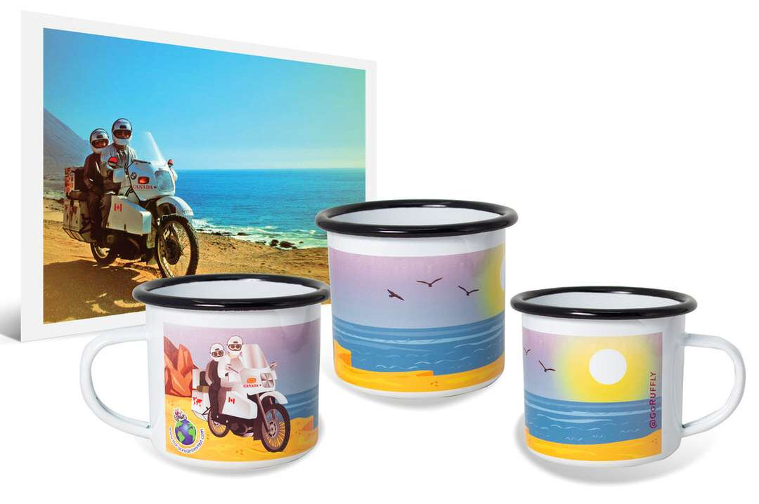 Photo of man and woman on travel motorcycle beside ocean next to custom enamel cups with wraparound artwork