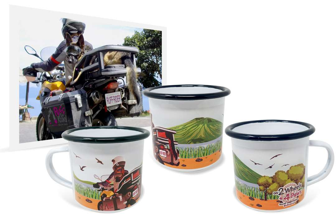 Photo of woman and German Shepherd riding motorcycle beside custom enamel camping mug with artwork