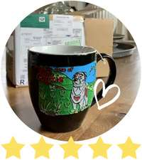 Personalized artwork on ceramic coffee mug of grey and brown dog