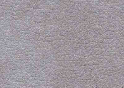 Square swatch of vinyl upholstery in silver fake rawhide leather