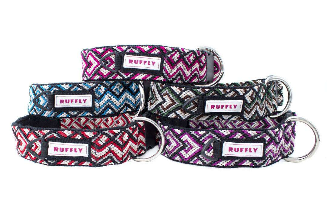 Stack of large handmade dog collars in five different colors with PVC labels