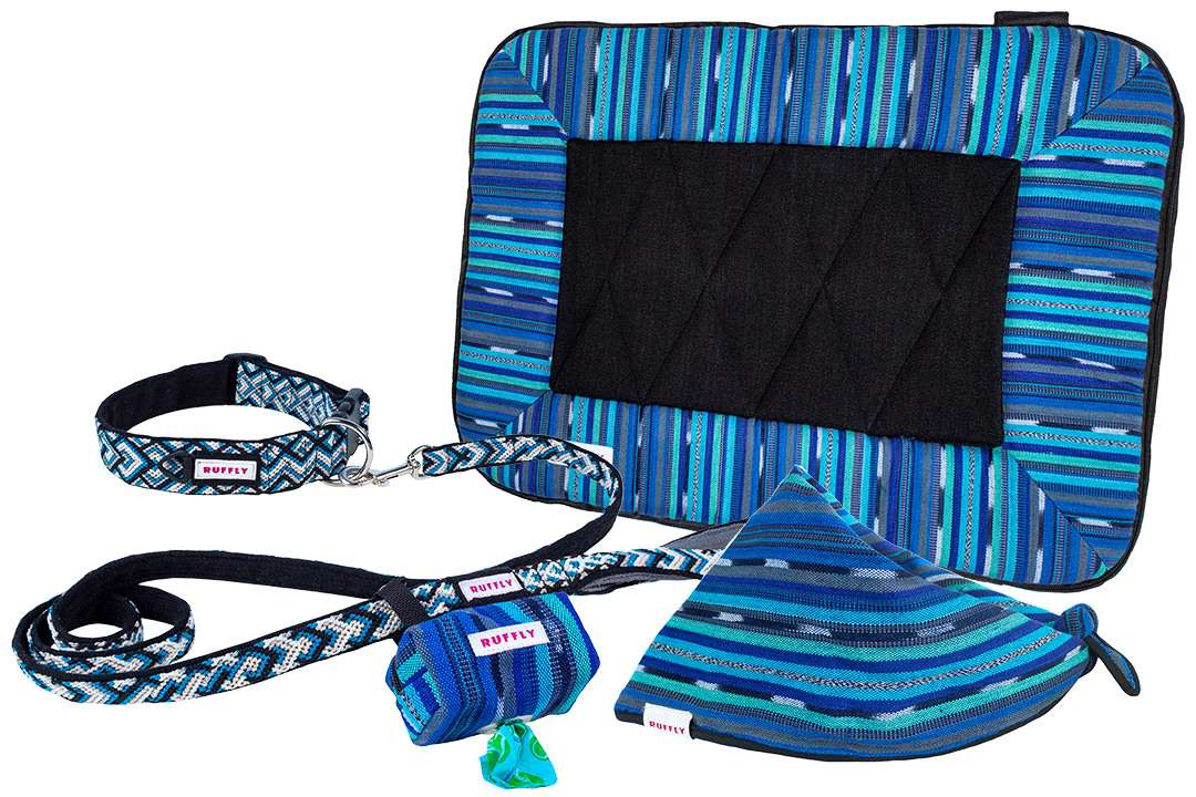 Matching outdoor dog gear includes collar, leash, poop bag holder, bed, and bandana in blue and black
