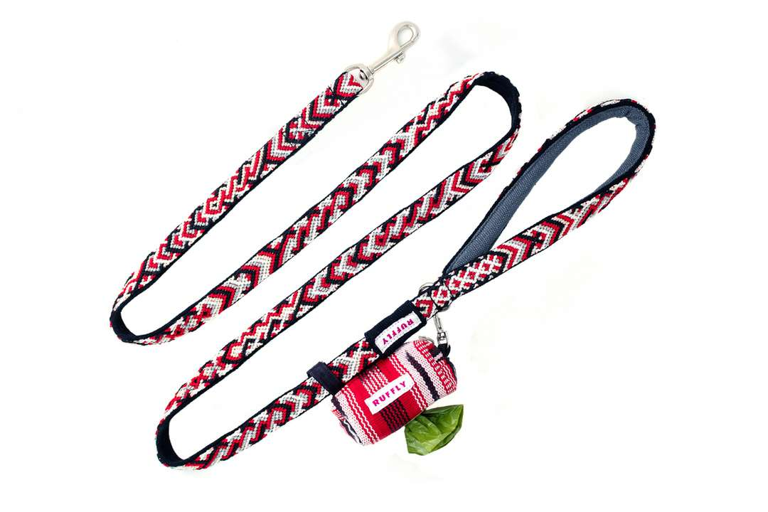 Red reflective outdoor dog leash with teardrop-shaped handle and matching poop bag holder connected at stainless D-ring