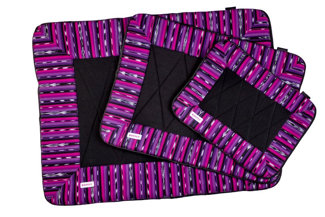 Pink and purple dog travel bed arranged in three different sizes