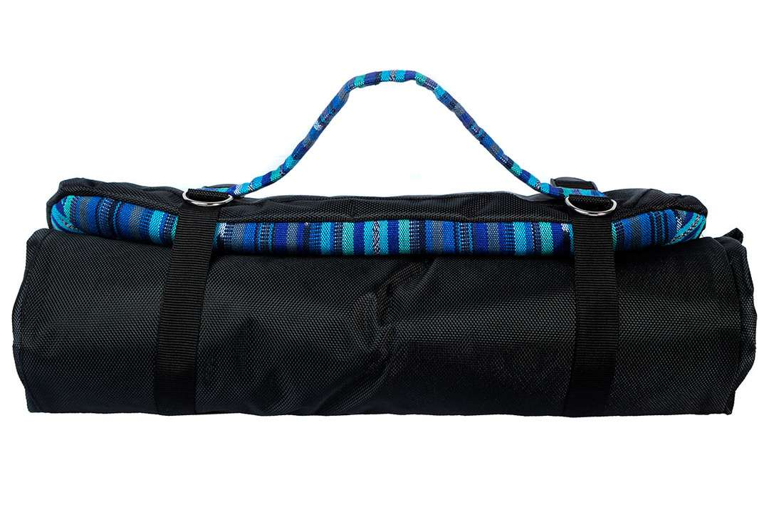 Dog travel bedroll with handwoven top rolled up for travel with matching carrying strap