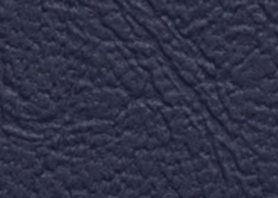 swatch of vinyl upholstery in navy blue stylish texture