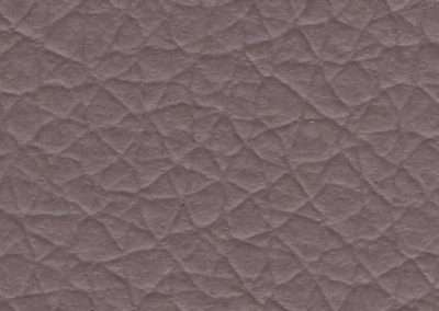 swatch of vinyl upholstery in mauve fake rawhide leather