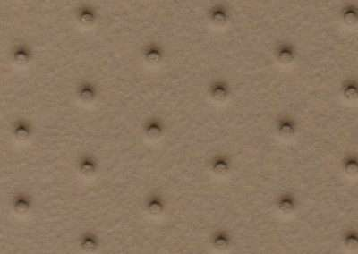 swatch of vinyl upholstery in beige dimples pattern