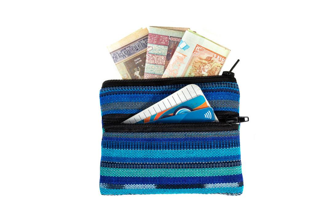 Credit cards and cash in blue handwoven leather-free change purse with two zippered compartments