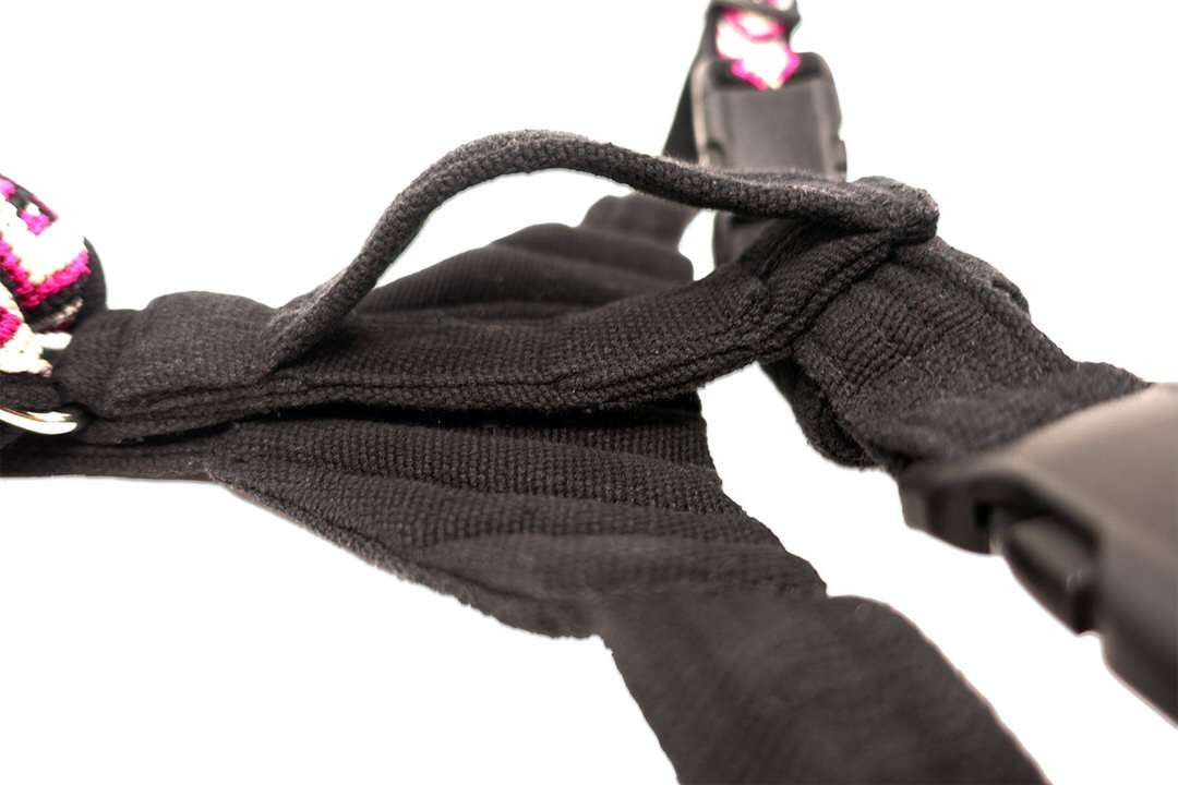Closeup of handle strap on back of motorcycle dog harness with black fabric
