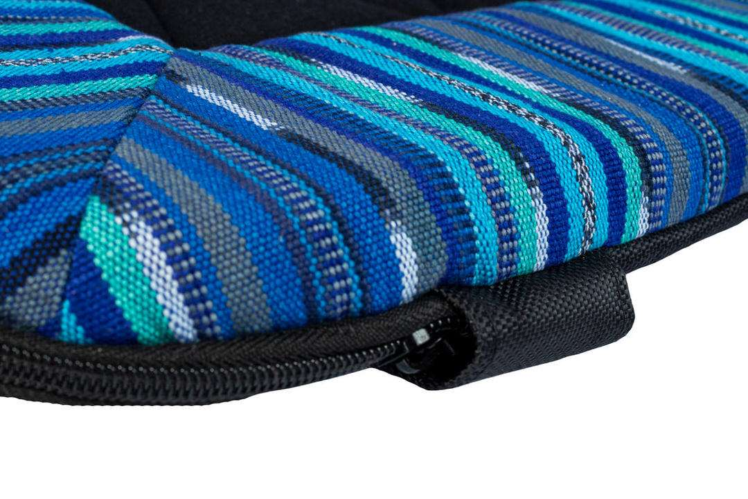 Corner of dog travel bed in sea blue pattern with no-chew zipper hood protection