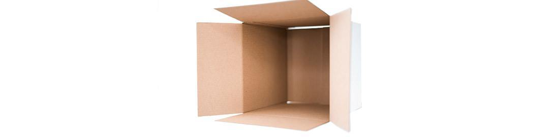 Empty cardboard box lays on it sides