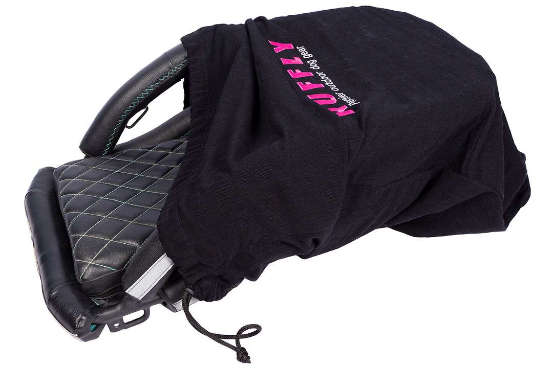 Top side view of small motorcycle dog carrier partially enclosed in handwoven cotton gear sack