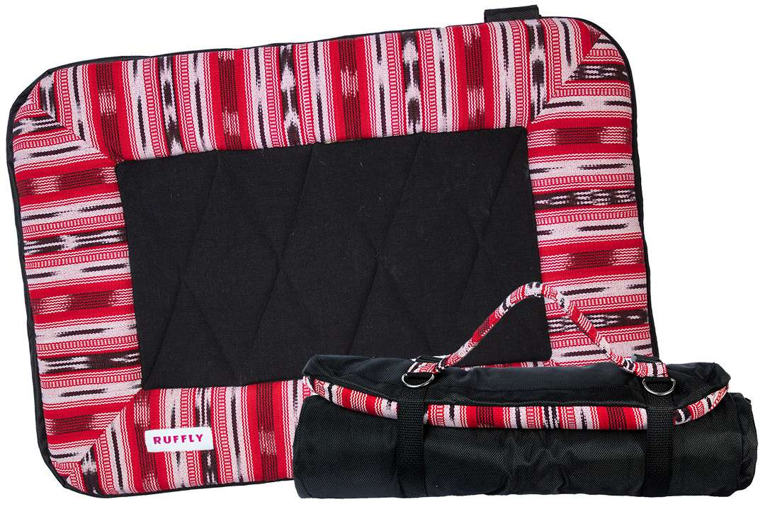 Red and black dog travel bed in size small open and rolled up with carrying strap